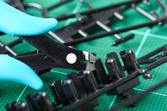 Plastic nippers. Using plastic nippers cut the plastic injection molding parts Stock Photography