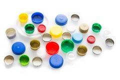Plastic noten en kappen op een wit concept als achtergrond/recyclings royalty-vrije stock foto's