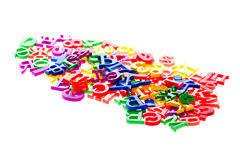 Plastic numbers and letters Stock Images