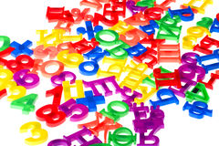 Plastic numbers and letters close up Royalty Free Stock Photo