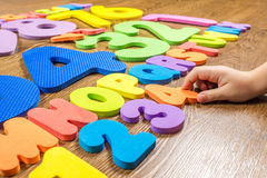 Plastic numbers and letters on wooden background Stock Images