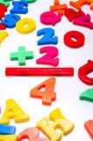 Plastic Numbers - Mathematics. Brightly colored plastic letters on a white background -numbers - Mathematics Royalty Free Stock Images