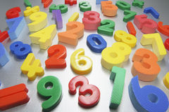 Plastic Numbers. On Silver Grey Background Royalty Free Stock Images