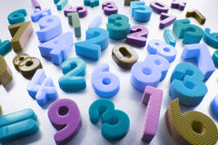 Plastic Numbers. On Silver Grey Background Royalty Free Stock Photography