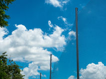 Plastic nylon net with pole under the blue sky. And cloud background Stock Image