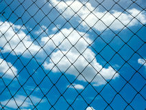 Plastic nylon net under the blue sky. And cloud background Royalty Free Stock Photo