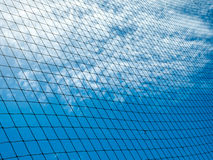 Plastic nylon net under the blue sky and cloud. Background Stock Photography