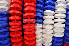 Plastic objects. Red, white and blue plastic disc for division of swimming pool lines Royalty Free Stock Images