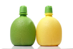 Plastic Orange and Lemon Juice bottles Royalty Free Stock Image