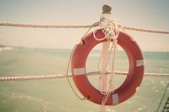Plastic orange lifebuoy belt Stock Images