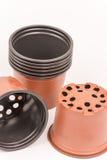 Plastic orange round flower pots Royalty Free Stock Photo