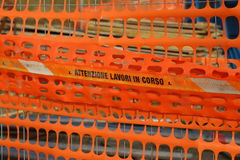 Plastic orange safety net to delimit the area of a road construc Royalty Free Stock Photography