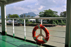 Plastic orange saving belt by the railing fence of the ferry to Samui island, Thailand Stock Image