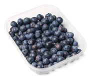 Plastic packaging of fresh juicy blueberries. White isolated background. Top  view stock photography