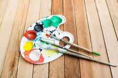 Plastic paint palette with paint and brushes Stock Photo
