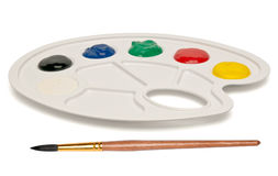 Plastic palette with a brush and paints Stock Images
