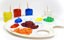 Plastic palette with paints. Plastic palette with colored paints and toothpicks in jars stock image