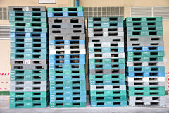 Plastic pallets are stacked can cause accidents. Plastic pallets are stacked can cause accidents in factory Stock Photos
