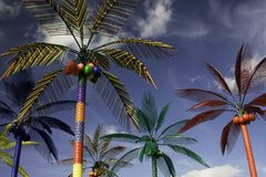Plastic Palm Trees against Blue Sky Stock Image