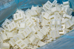 Plastic parts in a cardboard box Stock Images