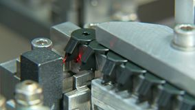 Plastic parts on a conveyor in an assembly machine stock footage