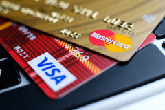 Plastic payment Master Card and Visa macro on the laptop keyboard Royalty Free Stock Image