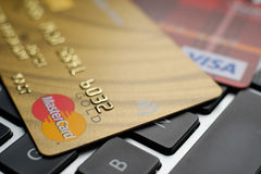 Plastic payment Master Card and Visa macro on the laptop keyboard Royalty Free Stock Photo