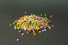 Plastic pellets . Plastic granules after processing .Polymer. Agent background black chemical chemistry extrusion factory grain granulate heap high density stock photo