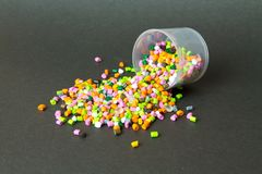 Plastic pellets . Plastic granules after processing .Polymer. Agent background black chemical chemistry extrusion factory grain granulate heap high density stock photography