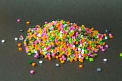 Plastic pellets . Plastic granules after processing .Polymer. Agent background black chemical chemistry extrusion factory grain granulate heap high density stock photos