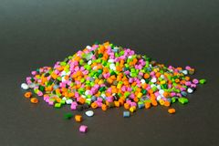 Plastic pellets . Plastic granules after processing .Polymer. Agent background black chemical chemistry extrusion factory grain granulate heap high density royalty free stock photo