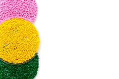 Plastic pellets green yellow and pink . Colorant for polymers in granules. Template. Plastic pellets green yellow and pink . Colorant for polymers in granules Stock Image
