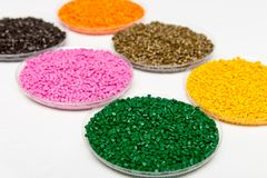 Plastic pellets .Polymeric dye в granules. The recycling of plastic. Granular colored plastic granules.  Royalty Free Stock Photos