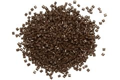 Plastic pellets. Polypropylene granules of brown Polymeric dye. Plastic pellets. Polypropylene granules of brown on a white background. Polymeric dye Royalty Free Stock Photography