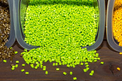 Plastic pellets are poured from a measuring container on laborat. Ory table Royalty Free Stock Image