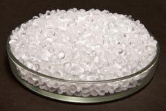 Plastic pellets. Transparent Polyethylene granules. Plastic Raw. Material .High Density Polyethylene (PE-HD). PE-LD hdpe idpe polypropylene resin royalty free stock images