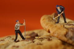 Plastic People Working on Chocolate Chip Cookies Stock Photography