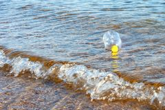 Plastic pet bottles in the sea and on the beach. The concept of environmental pollution and ecological disaster