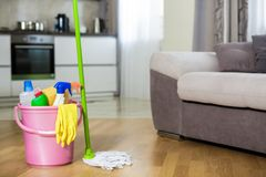 Plastic bucket with cleaning product at home Stock Photos
