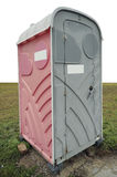 Plastic pink toilet. Cabin in a grass empty meadow . Mass production Stock Photography