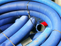 Plastic pipes. Coils of blue corrugated plastic pipes Royalty Free Stock Images