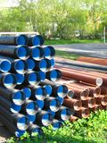 Plastic pipes. Stack of color plastic sewer pipes Royalty Free Stock Photo