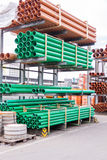 Plastic pipes in a factory or warehouse yard. Plastic pipes stacked in a factory or warehouse yard for use in plumbing or sewage installations on a construction Stock Photography