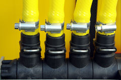 Plastic pipes and fittings. Yellow plastic pipes with clamps Stock Photography