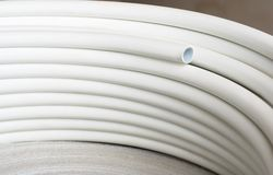 Plastic pipes in roll. Plumbing plastic pipes in roll royalty free stock photography