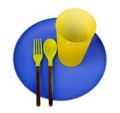 Plastic plaat, kop, lepel en vork Royalty-vrije Stock Foto