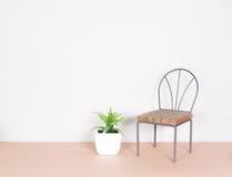 Plastic plant and mini chair, minimalism style Royalty Free Stock Images