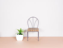 Plastic plant and mini chair, minimalism style Stock Images