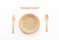 plastic plate spoon fork and knife Stock Photo