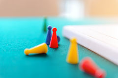 Plastic play figures. Game concept. Selective focus on yellow play figures Royalty Free Stock Image